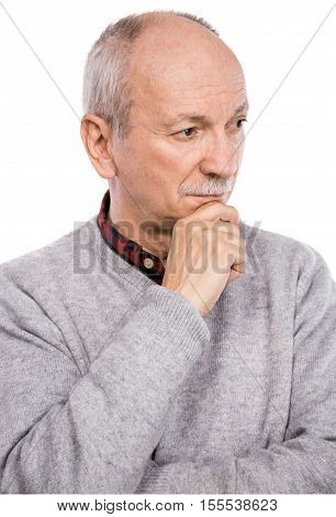 Portrait of a senior thoughtful man posing on a white; background