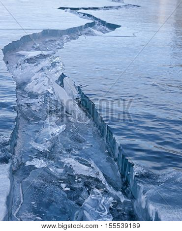 Texture of natural Lake Baikal ice with big crack in Siberia