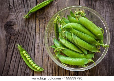 Fresh, Young Unpeeled Green Peas In A Glass Plate