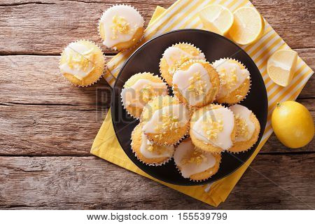 Homemade Lemon Muffins Sprinkled With Zest Close-up On A Plate. Horizontal Top View