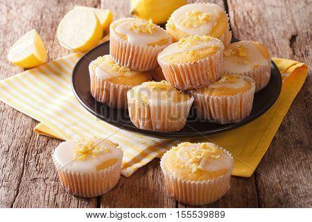 Delicious Freshly Baked Homemade Lemon Muffins Zest Sprinkles Closeup. Horizontal