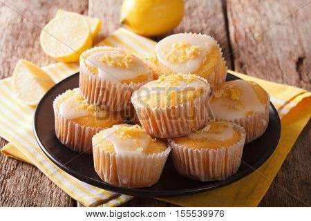 Sweet Lemon Muffins With Zest And Icing Sugar Close-up On A Plate. Horizontal