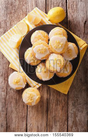Homemade Lemon Muffins Sprinkled With Zest Close-up On A Plate. Vertical Top View
