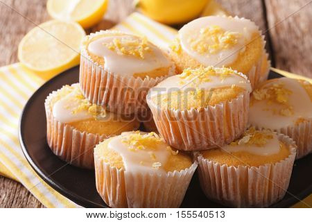 Homemade Lemon Muffins Sprinkled With Zest Close-up On A Plate. Horizontal