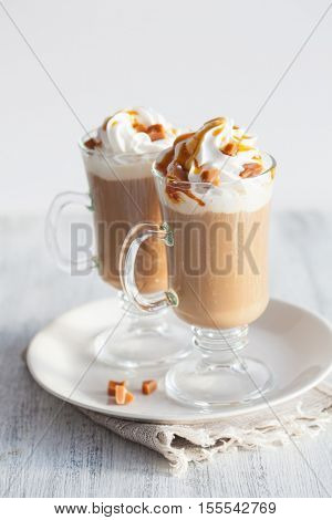 latte with whipped cream and caramel