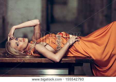 Beautiful lady in long dress posing in the night city