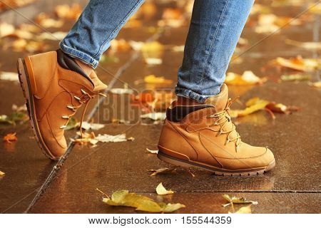 Woman walking on autumn street
