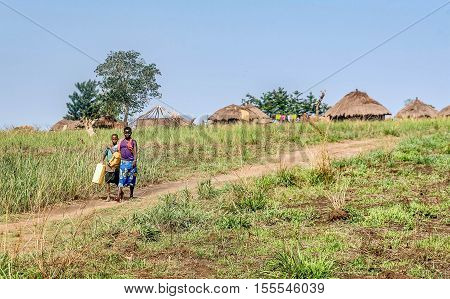 Uganda, Africa-  April 2, 2016: African women going to get water in the Village in Uganda Africa