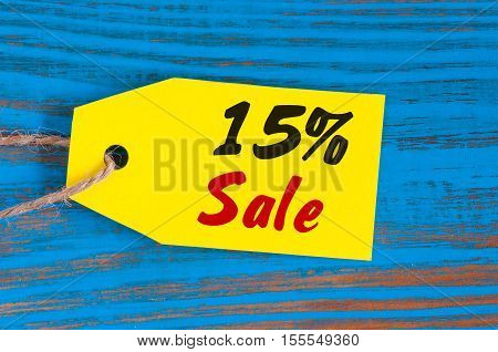 sale minus 15 percent. Big sales fifteen percents on blue wooden background for flyer, poster, shopping, sign, discount, marketing, selling, banner, web