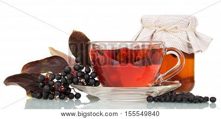 Cup of tea rosehip berries, soda cans and elderberries isolated on white background.