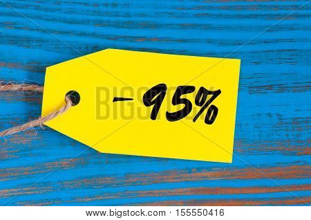 sale minus 95 percent. Big sales ninety five percents on blue wooden background for flyer, poster, shopping, sign, discount, marketing, selling, banner, web