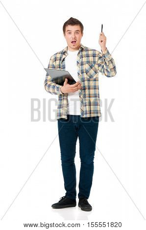 Full length portrait of a young man holding clipboard. Handsome businessman pointing up with pen. Young guy with creative idea for success and profit, isolated on white background.