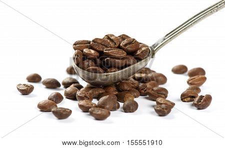Coffee Beans In Reto Spoon. Isolated