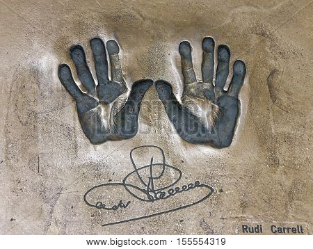 Bremen, Germany - Sep 4, 2016: Print of hands and signature of Rudi Carrell. Both hands on cement mortar wall, Bremen, Germany