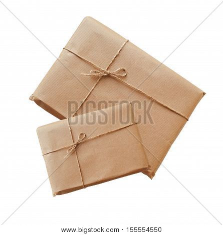two envelopes kraft paper tied with string on a white background.