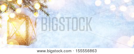 Blue Christmas; Christmas tree and Holidays light on snow background