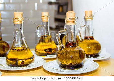 several receptacles with olive oil with spices for pizza