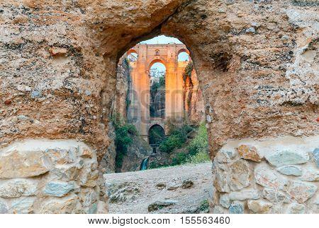The unique stone bridge across the gorge in the village Ronda. Spain. Andalusia.