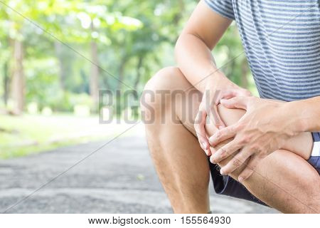 Man having knee pain while exercising Sport injury concept