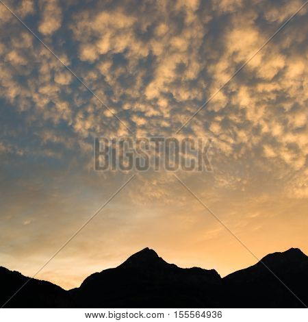 Clouds over the mountains. After sunset. Uri