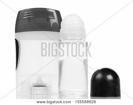 Lotion and deodorant roll isolated on white background.