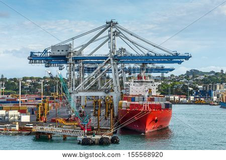 Industrial Container ship in the harbor - international freight shipping Auckland New Zealand