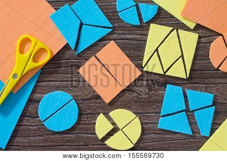 Puzzle Study Of Mathematical Fractions And Square Gather On The Wooden Table. The Concept Of Early C