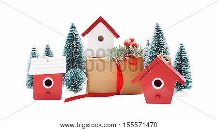 Christmas linear arrangement of birdhouses trees and gift boxes isolated on white