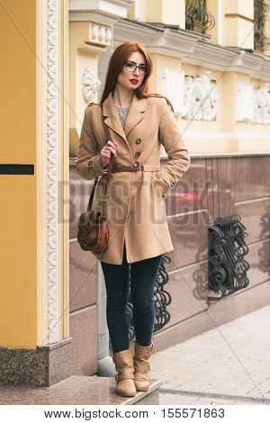 Business Woman Go To Work In A Beautiful Coat With A Bag