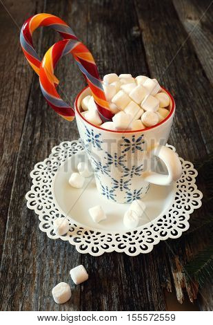 New Year's mug with marshmallows and sucking candy. Toned image