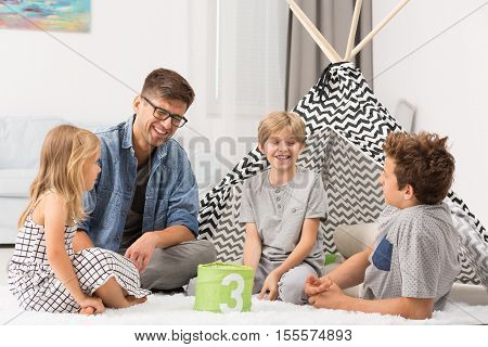 Male Babysitter Playing With Children