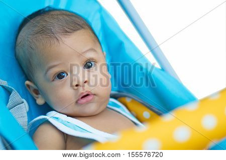 Close Up Of Asian Baby Boy  Age 6 Month - 1 Year In Stroller