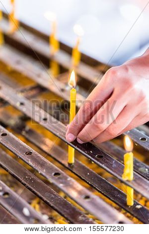 Light Candles For Buddhist Worship Buddha.-solf Focus , Tample, Thailand