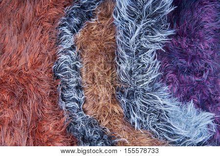 Multicolored curly fluffy yarn wool yarn. Texture, background