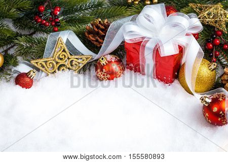christmas red gift with branch firtree and decoration. studio shot