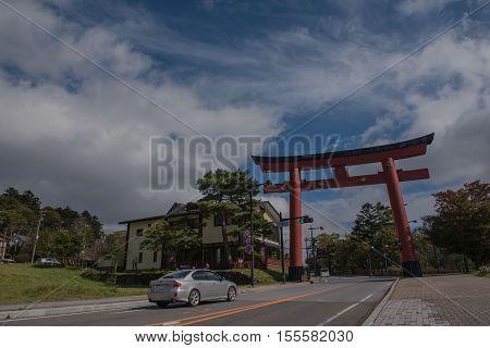 NIKKO, JAPAN - OCTOBER 13 ,2016 :  Massive torii gate of Futarasan  near of lake Chuzenji at Nikko