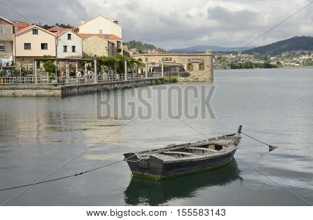 COMBARRO, SPAIN - AUGUST 4, 2016: Wooden rustic boat in the ria of the fishing village of Combarro in the province of Pontevedra in the Galicia region of Spain.