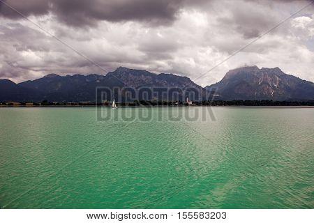 Boats and panoramic views of Forggensee lake Germany