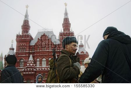 MOSCOW - NOVEMBER 04 2016: Reenactor dressed as Soviet army soldier poses for photos on the Red Square in Moscow on occasion of historical military parade (November 07 1941) anniversary.