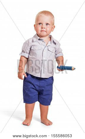 Charming boy in a shirt and shorts standing and holding a big pencil isolated on white background.