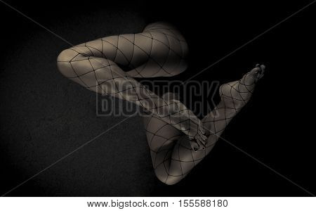 Low key special toned photo of sexy female nude legs in net tights against dark background