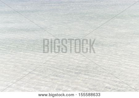 White salt surface under clear water of Baskunchak lake, Russia.