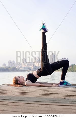 Fitness Woman Doing Butt-sculpting Exercises During Training Workout Outdoor