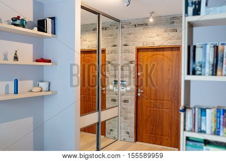 Entrance Hall In Modern Apartment With Mirror Wardrobe