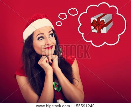 Praying Woman In Santa Claus Christmas Costume Looking Up And Making A Wish With The Gift Box In Dre