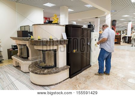 Khimki, Russia - September 03.2016. The buyer chooses metal safes in the largest furniture store Grand