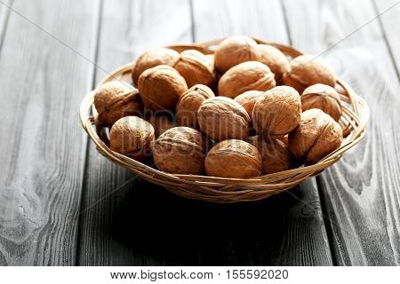Walnuts on a black wooden table, close up