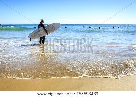 Surfers On Beliche Beach, Sagres, Algarve, Portugal