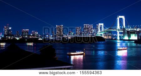 nightscape of Tokyo city view on the bay and the Rainbow bridge Japan