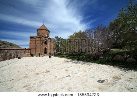 VAN,TURKEY-APRIL 28: Unidentified tourists visiting the Akdamar Church.Armenian Church of the Holy Cross stands on Akhtamar Island (Akdamar) in Lake Van on April 28,2015 in Van,Turkey.